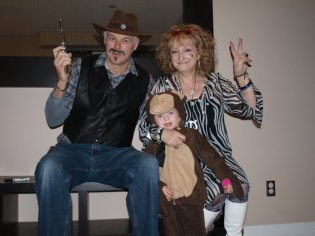 The parentals with Rylie the monkey on Halloween
